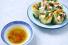 Rainbow Rice Paper Rolls Recipe Appetizers with rice paper, chicken breasts, garlic cloves, olive oil, sesame oil, soy sauce, carrots, cucumber, iceberg lettuce, capsicum, purple onion, mint leaves, chopped walnuts, water, honey, lime juice, fish sauce, chillies, garlic cloves