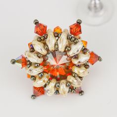 Starburst rivoli frame / bezel earring tutorial - Eureka Crystal Beads.  superduos