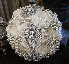 """Romantic Ivory Brooch Bouquet - $495 FULL PRICE IS $495, DEPOSIT TO PLACE ORDER $295, BALANCE OF $200 DUE @ COMPLETION Custom 9"""" flowered Bridal Brooch bouquet in Soft Pale Ivory. Custom made Silk Flo"""