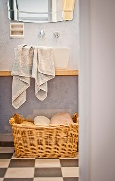 Store towels in a wicker basket, and drape used ones on the wall. | @Design*Sponge Photo by sivanaskayo.com
