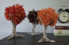 Paper bag/yarn pom pom autumn trees: remind me of something from Dr. Seuss! Would be cute in a little group on a side table, etc. . . . and would be a fun craft for kids.