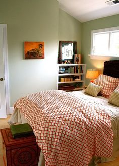Green bedroom with pop of red