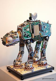 DESCRIPTION AND DETAILS:  An upcycled version of the Imperial AT-AT Walker created using recycled materials such as: data cables, circuit boards, computer chips, wire, heat sinks, keyboard keys, and adding machine parts.   Date Completed: 9-7-2014  Dimensions: 30 1/2 inches tall , 30 inches wide and 14 inches deep.   See more of my creations at gabrieldishaw.com #imperialwalker #upcycled #recycled #junkart #sculpture #gabrieldishaw #starwarsart #starwars