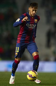 Neymar JR of Barcelona runs with the ball during the La Liga match between Elche FC and FC Barcelona at Estadio Manuel Martinez Valero on January 24, 2015 in Elche, Spain.