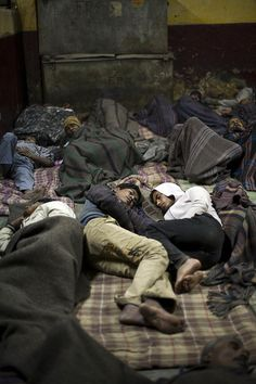 www.ActionAid.org  Two young homeless friends lie together in the Fatepuri night shelter for the homeless in Old Delhi, India.    Until a few years ago, urban poverty, whilst being starkly visible to the policy makers in India, received far less attenti