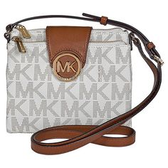 This authentic Michael Kors handbag is made of logo-embossed PVC. This Michael Kors Fulton Crossbody features a top zip and magnetic snap closure, adjustable shoulder strap, an all over MK logo print, gold-tone hardware and logo plaque, interior zip and t Large Crossbody Bags, Crossbody Shoulder Bag, Shoulder Handbags, Shoulder Bags, Shoulder Strap, Purse Crossbody, Michael Kors Shoulder Bag, Michael Kors Crossbody, Handbags Michael Kors
