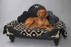Royal Pet Bed - LARGE  Duchess of Heart makes high quality dog beds, beds that are fit for the Kings and Queens of dogs! The high quality wood workmanship and the intricate carvings and ornaments are unique in the limited world of dog beds. It gives a look of European refinement and elegance for the snootiest of furries!!! They can easily be folded flat for travel and toted in its own traveling case. The mattress is high quality down and cotton which can be washed and personalized with your…