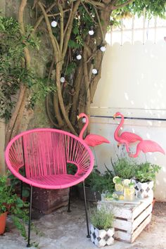 the perfect equation: plants+ceramic tiles+garland lights+flamingos+pink chair
