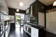 Resene Nero kitchen walls with Resene Alabaster cabinets.