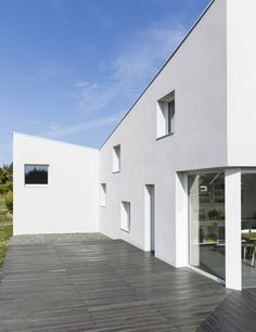 Square windows puncture Alireza Razavi's monolithic House for a Photographer in Brittany