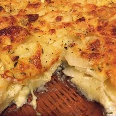 Delicious, easy, cheesy scalloped potatoes recipe. Perfect for Thanksgiving!