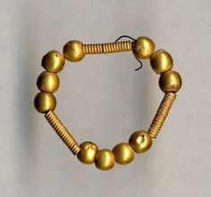 Gold Necklace Made in the Levant 1650-1050 BC Found in a tomb at Episkopi-Bamboula, Cyprus Late Cypriot(?) (Source: The British Museum)