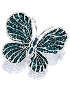 Alexandrite and Diamond 'Butterfly' Brooch Modelled as a butterfly, the wings set with variously-shaped alexandrites together weighing approximately 15.35 carats, decorated by circular-cut diamonds together weighing approximately 1.55 carats, mounted in 18 karat white gold.