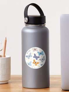"""Butterflies"" Sticker by Loucreations | Redbubble Little Flowers, Artist Names, Glossier Stickers, Mask For Kids, Art Boards, Finding Yourself, Water Bottle, Bloom, Butterfly"