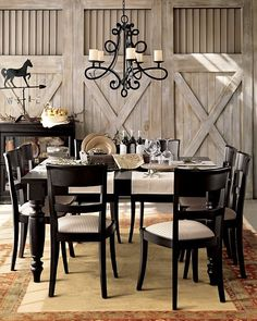 Equestrian dining room. I like the barn door style walls