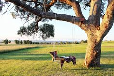 Beautiful wooden swing sets clearance in Landscape Farmhouse with Sloped Backyard Ideas next to Kid-friendly Backyard Ideas alongside Beautiful Big Houses and The Most Beautiful Houses