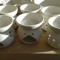 Bisque ready to glaze ~ 2 Essential Oil Burners left ~ ready around 9-12 December.  1 Berry Bowl and saucer, 1 Cafe Au Lait Mug 2 Butter Dishes (butterflies or swirls)  #oilburner #butterdish #berrybowl #cafeaulait #wheelthrown #studiopottery #etsyseller