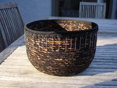 example of beaded trim, top edge finished with binding, very ethnic with the dark colors, cotton clothesline fabric bowl
