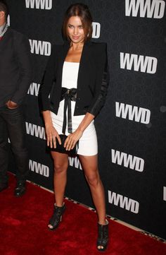 Irina Shayk Ankle boots Irina Shayk added a little edge to her sleek cropped jacket and white mini dress with zip-up ankle boots.