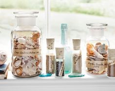 seashell collection in glass jar  (10 Summer Seashell Decor Ideas)    You can label each jar to show where the shells came from.