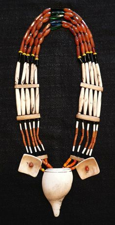 Naga necklace (Nagaland, India). It wonderfully combines carnelians at the top (with some other beads), below it a layer of elongated shell beads, and then a nice mixture of further beads, with shell pieces at the bottom, including a big and good slice of conch shell.