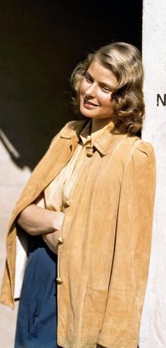Ingrid Bergman 40s casual day sports wear tan jacket blouse pants pleated hairstyle color photo print ad snapshot movie star