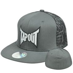 "Tapout Cage Fighting UFC MMA Stretch Flex Fit Large XLarge Flat Bill Hat Cap by Tap Out. $19.99. Flex Fit. 97% Cotton 3% Spandex. FlexFit Large - XLarge. Brand New Item with Tags. Official Licensed Product. Authentic Tapout Flat Bill Flex Fit Hat. ""TAPOUT"" embroidered on front panel. Right side panel and left side panel both have embroidered tap out designed. Plain back panel. Flex Fit hat, fits sizes Large to XLarge. Grey flat bill visor. Officially Licensed Tapout product."