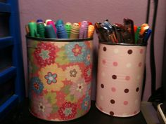 empty (and cleaned) veggie cans with scrap paper wrapped around. pen holders