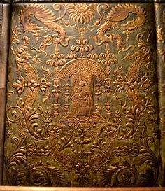 Before there was wallpaper there was gilded leather. Wealthy homeowners decorated their walls with panels of leather such as these. Gilded leather is a bit of a misnomer. It's actually leather covered with a silver foil. To keep the silver from oxidizing a varnish was applied that gave it a golden color.