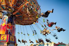 This is and has always been one of my favorite carnival rides...I love the feeling of being swung through the air, wind rushing by, emotionally driven music pounding, and that pleasant summer carnival scent in the air.