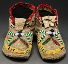 A PAIR OF SIOUX BEADED HIDE MOCCASINS . c. 1900... American Indian   Lot #50193   Heritage Auctions
