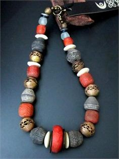 Spectacular Old African Trade Beads Necklace    Old African Trade Beads combine on this spectacular large Necklace for an infinitely Tribal experience. Alternating series of large Old Mali Terracotta Beads, Kenyan Camel Bone, Nigerian Stone, and Recycled Glass balance perfectly with wound Ghana Brass beads. Old beads newly strung by South African Jewelry artisans known for their creative use of old beads gathered from the far reaches of the African continent.