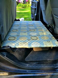 Build a platform for the back seat of a truck/SUV/van with flip up seats. Creates a flat surface for cargo and pets and offers extra storage beneath it!