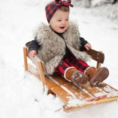 Christmas Cutie ❤️️ Can't get enough of her buffalo plaid!! We seriously have the cutest customers ever!! #shopsugarbabies #snow #buffaloplaid #sledding #photography #snowfun #kidsfashion #sugarbabies #cutekids #getthelook #cutestcustomersever