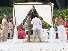 Jason Aldean and Brittany Kerr Wedding Photos: The groom dressed for the beach vibe of the wedding, selecting a casual tan suit. And the bridesmaids wore crop tops (yes, crop tops), with flowy skirts for the couple's nuptials.