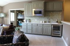 Gray bonus room wet bar cabinets with wine refrigerator by Burrows Cabinets Cabinet doors by TaylorCraft Cabinet Door Company Wet Bar Cabinets, Grey Kitchen Cabinets, Bonus Rooms, Extra Rooms, Wet Bar Designs, Room Above Garage, Wine Refrigerator, Cabinet Doors, Game Room