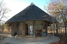 Kruger National Park - stayed in Rondawels like these on family holidays Kruger National Park, National Parks, Bungalow, Sand House, Backyard Covered Patios, Circle House, Earth Bag Homes, Hut House, Reptile House