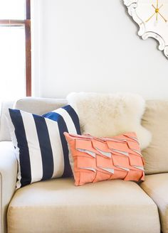 If you're looking for a way to spice up your living room, this Diy Structured Pleat Lumbar Pillow is the way to do it! Super easy and oh so unique..