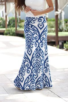 TO DIE FOR! This best seller Blue and Ivory Printed Maxi Skirt is finally BACK! It features a flawless fit and gorgeous print. - 94% Polyester - 6% Spandex Length: - small: 47 inches - medium: 47.5 in
