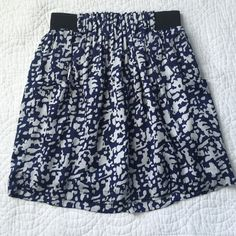Francesca's skirt Silky material. Skirt has a liner so it's not see through. Waist is an elastic band. Has pockets. Francesca's Collections Skirts