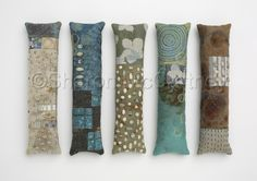 Mixed media collection of fabric and found object amulets. (Contemporary Fiber Art)