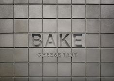 Japanese designer Yota Kakuda used a bespoke aluminium tile to cover the walls and floors in this shop that sells baked cheese tarts Restaurant Signage, Store Signage, Retail Signage, Wayfinding Signage, Signage Design, Storefront Signage, Bake Cheese Tart, Cheese Tarts, Industrial Signage