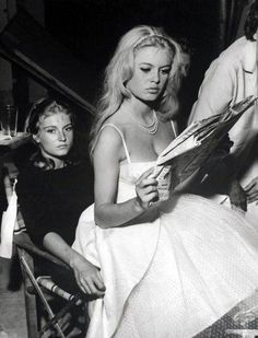Brigitte Bardot and her sister Mijanou 1959. This makes me laugh. She is sitting on her!