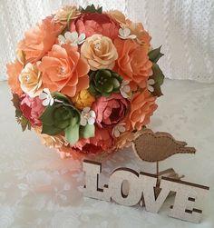A gorgeous paper flower bouquet designed by Anna Fearer #coral #peach #weddingbouquet #paperflowers #paperflowerbouquet #succulents #paperbouquet #bridalbouquet