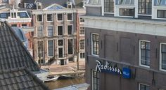 Radisson Blu Hotel, Amsterdam Amsterdam Radisson Blu Hotel is situated in a quiet part of Amsterdam's centre, just a 7-minute walk from lively Dam Square.  The spacious rooms are decorated according to colourful themes, including maritime and Scandinavian.
