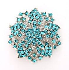 Gorgeous aqua blue brooch jewelry embellishment, which can be used for your DIY project - beach blue wedding, bridal jewelry, brooch bouquet charm handle, cake and frame decoration, corsage, event decor, crafts, scrap booking and much more. Size: 2 inch high 2 inches wide Stones color: