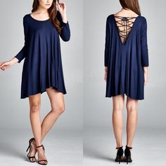 AALIYAH lace up detail dress - NAVY Loose fit, three-quarter length sleeves, round neck dress. Scoop V-back with lace up detail. Has center back seam. This dress is made with heavy weight knit jersey that is soft, drapes well and has great stretch. Fabric 95% Rayon, 5% Spandex Made in U.S.A. AVAILABLE IN BLACK & NAVY Dresses