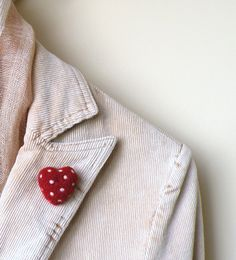 Talk about warm and fuzzy. Felted red heart brooch by AgnesFelt, $13.00.