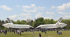 Space Shuttles Enterprise (left) and Discovery nose to nose at Smithsonian Annex.