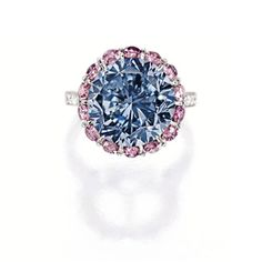 Exceptionally rare and highly important fancy vivid blue diamond, pink diamond and diamond ring. Photo: Sotheby's.  Centring on a brilliant-cut fancy vivid blue diamond weighing 7.59 carats, surrounded by brilliant-cut pink diamonds together weighing approximately 1.70 carats, to shoulders set with brilliant-cut diamonds, mounted in platinum.
